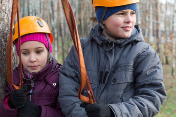 Boy and girl with climbing equipment ready for the passage