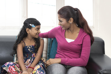Young Indian mum and daughter at home