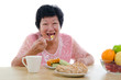 chinese senior female eating with isolated white background