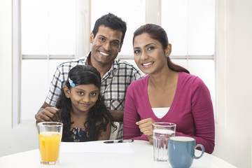 Indian family helping their child with her study work