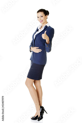 Happy business woman with ok gesture