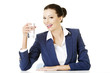 Businesswoman sitting at the desk and drinking mineral water