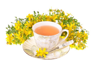 a cup of St. John's tea with fresh flowers on a white
