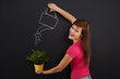 Smiling woman watering flower