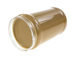 Jar of peanut butter on side
