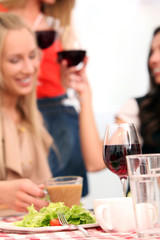 Beautiful caucasian women with red wine
