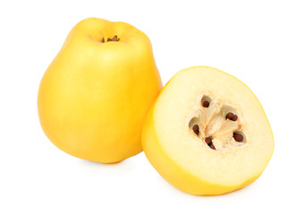 One whole and a half quince (isolated)