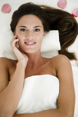 Young woman relaxing in health spa