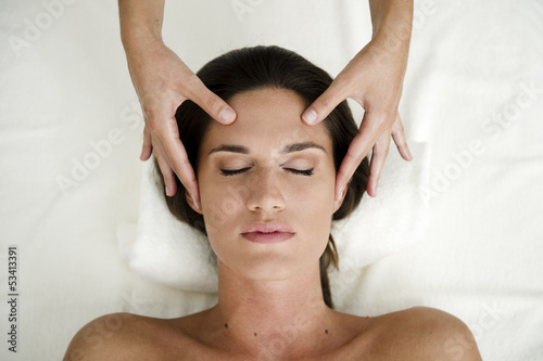 Young woman getting a facial massage