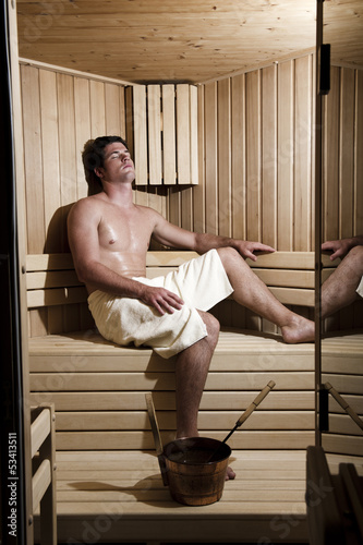 Young man relaxing in sauna