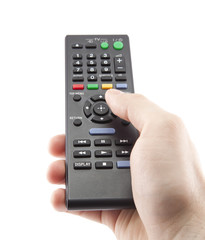 Hand pressing remote control isolated on white