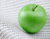 green apple on a binary code