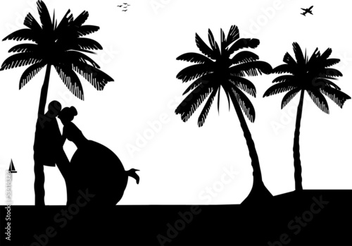 Wedding couple on the beach between the palms silhouette