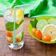 Cold fresh drink with lemon, lime, kumquat and mint.