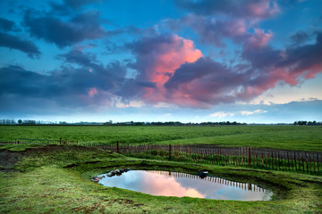 dramatic sunrise over little pond