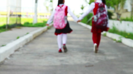 Little student girls going to school