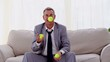Businessman playing with tennis ball