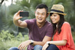Chinese Couple taking photo of themselves with smartphone