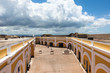 clouds form above the vibrant interior of El Morro Fort