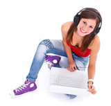 Smiling woman with headphones and laptop