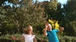 Happy siblings jumping together in their garden