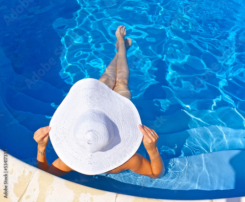 woman sitting in a pool