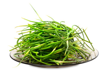 Fresh garlic scapes on plate