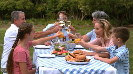 Family clinking glasses