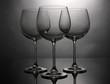 Empty wine glasses arranged on grey background