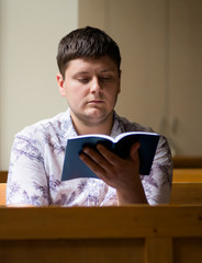 young man reading the bible