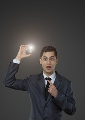 man holding a lamp