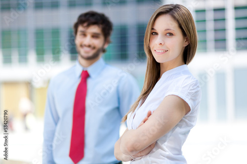 Two businesspeople in an urban setting