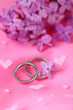 Beautiful wedding rings on pink background