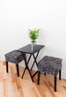 Black table with two chairs