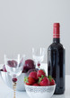 Red wine, plums and strawberries