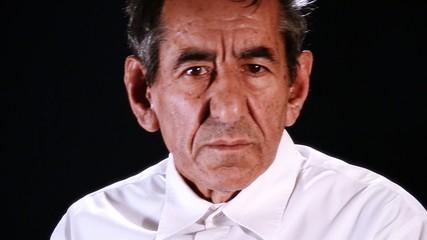 senior man on black background
