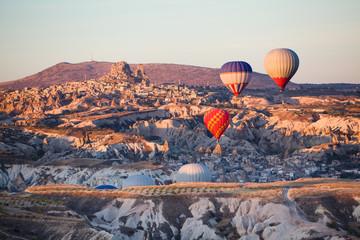 Balloons over Uchisar castle in Cappadocia