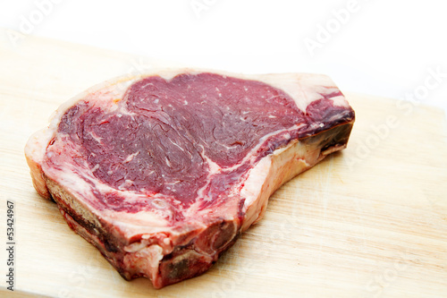 Raw dry aged t-bone steak
