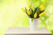 Beautiful tulip bouquet over garden bokeh background