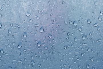superficie textil y gotas de agua