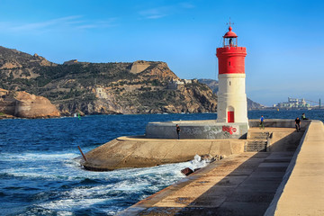 red and white lighthouse at the port of Cartagena, Spain