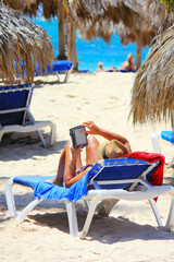 Woman reading book in Bermuda Beach
