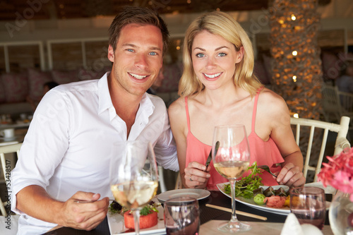 Couple Enjoying Meal In Restaurant