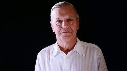 an elderly man, portrait on black