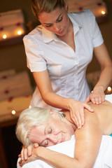 Senior Woman Having Massage In Spa