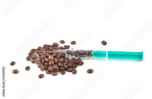 Medical syringe full of coffee