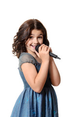 happy child singing with microphone