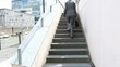 Businesswoman walking upstairs in city