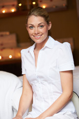 Portrait Of Female Masseuse At Health Spa