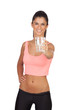 Attractive brunette girl drinking water during training